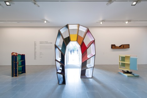 Martino Gamper Installation view, design is a state of mind Left to right: Gaetano Pesce Nobody's Shelves Short Body 2002 Coloured polyurethane resin Courtesy of Nilufar Gallery Martino Gamper L'Arco della Pace 2009 Coloured veneer, poplar plywood Courtesy of Martino Gamper Co-produced by Museion, Bolzano, Italy and Pinacoteca Giovanni e Marella Agnelli, Turin, Italy Giò Ponti Altamira 1950-1953 Oak Courtesy of Nilufar Gallery Claudio Salocchi Bookcase 1960 Metal, lacquered wood Courtesy of Nilufar Gallery Photograph: © 2014 Hugo Glendinning